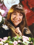 Mayim Bialik smiling in Portrait with Flowers Photo by  Movie Star News