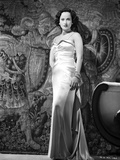 Merle Oberon on a Silk Dress standing Photo by  Movie Star News