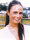 Jordana Brewster wearing a White Tunic and a Crucifix Necklace in a Close Up Portrait Photo by  Movie Star News
