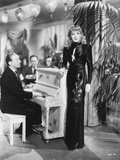 Marlene Dietrich standing in Black Gown with Cast Photo by  Movie Star News