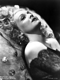 Madeleine Carroll Lying in Black Dress with Curly Hairstyle Photo by  Movie Star News
