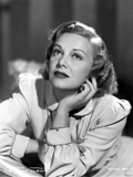 Madeleine Carroll Looking up in White Dress with Head Leaning on Hand Photo by  Movie Star News