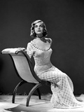 Lizabeth Scott Seated in Chair wearing Long Gown Photo af Movie Star News