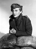 Madeleine Carroll Leaning on Sandbags, wearing Black Suit with Hat Photo by  Movie Star News