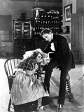 John Barrymore sitting on the Table and Accompanying an Old Lady Photo by  Movie Star News