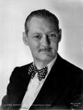 Lionel Barrymore Posed in Black Suit with Polkadot Bowtie in Classic Portrait Photo by  Movie Star News