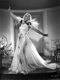 Marion Davies posed in Feather Dress in Black and White Photo by  Movie Star News