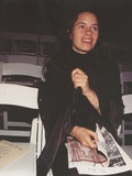 Natalie Merchant Seated in Black Robe Photo by  Movie Star News