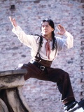 Jackie Chan Posed in Red Scarf Photo by  Movie Star News