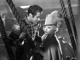 Marion Davies Along With A Man in Prince Outfit in Black and White Photo by  Movie Star News