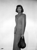 Jane Wyman Posed in Grey Linen Long Sleeve Tweed Suit Dress and Long Skirt with Right Hand Holding  Photo by  Movie Star News