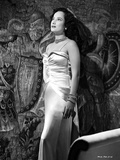 Merle Oberon standing a Silk Gown Photo by  Movie Star News