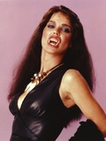 Liz Brooks Portrait in Black Dress with Vampire Teeth Photo by  Movie Star News