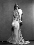 Margaret Sullivan standing in White Gown with Hat Photo by  Movie Star News