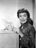 Jane Wyman Posed in Black Velvet Bishop Sleeve Poet Dress with Hands Holding A Glass Swan Figure Photo by  Movie Star News