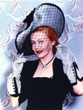 Madeleine Carroll smiling in Black Dress With Hat Photo by  Movie Star News