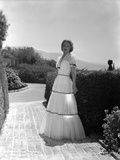 Madeleine Carroll standing in White Gown Photo by  Movie Star News