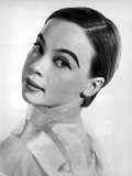 Leslie Caron posed on Side Ways in White Background Photo by  Movie Star News