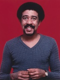 Richard Pryor smiling in Blue Sweater Photo by  Movie Star News