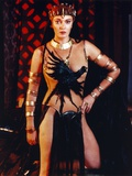 Sarah Douglas Posed in Crow Printer Dress with Gold Bracelets Photo by  Movie Star News