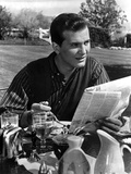 Pat Boone Reading in Formal Attire With Newspaper Photo by  Movie Star News