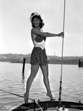 Mary Martin on a Printed Dress standing on a Boat Photo by  Movie Star News