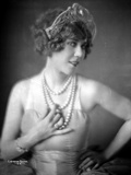 Louise Fazedna on a Pearl Necklace with Hand on Waist Photo by  Movie Star News