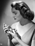 Patricia Neal Holding Perfume in Classic Photo by  Movie Star News