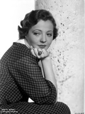 Sylvia Sidney sitting and Leaning Face on Hand in Printed Dress Photo by  Movie Star News
