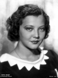 Sylvia Sidney wearing a Black Blouse with White Collar Photo by  Movie Star News