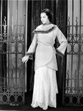 Sylvia Sidney wearing a Coat and White Gown Under Photo by  Movie Star News