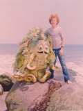 Sigmund & The Sea Monster standing on a Rock in the Sea with the Sea Monster in a Movie Scene Photo by  Movie Star News