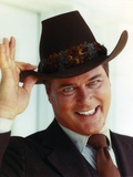 Larry Hagman smiling in Brown Coat Photo by  Movie Star News
