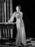 Sylvia Sidney standing in a Gown Photo by  Movie Star News