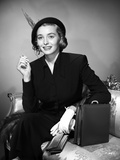 Patricia Neal Seated in Formal Attire with Hat Photo by  Movie Star News