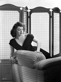 Ruth Roman Posed on Couch wearing Black Gown Photo by  Movie Star News
