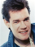 Randy Travis smiling in Close Up Portrait wearing Blue Denim Jacket Photo by  Movie Star News
