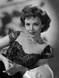 Laraine Day posed wearing Necklace and Black Dress in Black and White Photo by  Movie Star News