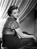 Sylvia Sidney sitting in a Black Skirt and Shining Blouse Photo by  Movie Star News
