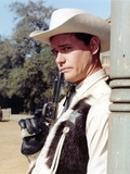 Larry Hagman smiling in Sheriff Uniform Holding a Pistol Photo by  Movie Star News