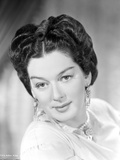 Rosalind Russell smiling with Victorian Hairstyle Photo by  Movie Star News