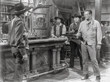 Rio Bravo Pointing Gun to a Man in Cowboy Outfit Photo by  Movie Star News