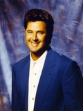 Vince Gill smiling in Blue Coat Photo by  Movie Star News
