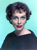 Phyllis Kirk wearing Black Sweater with Red Lips Portrait with Lightblue Background Photo by  Movie Star News