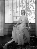 Talullah Bankhead sitting in Embroidered Dress Photo by  Movie Star News