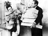 Rosalind Russell in Fur Coat with Man Carrying Presents Photo by  Movie Star News