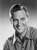 William Holden smiling in Checkered Polo with Brush Up Hairdo Photo by  Movie Star News