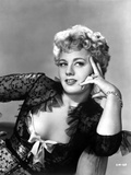 Shelley Winters sitting on Chair in Black Sheer Lace Elbow Ruffle Long Sleeve Dress Photo by  Movie Star News
