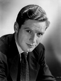 Richard Basehart smiling in Black Suit Photo by  Movie Star News