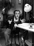 William Powell sitting on Chair, wearing Black Coat Photo by  Movie Star News